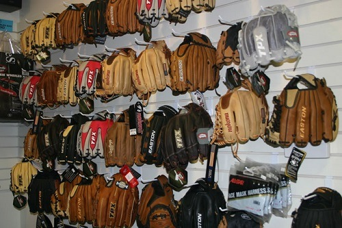 Multiple Softball Gloves Displayed in Store